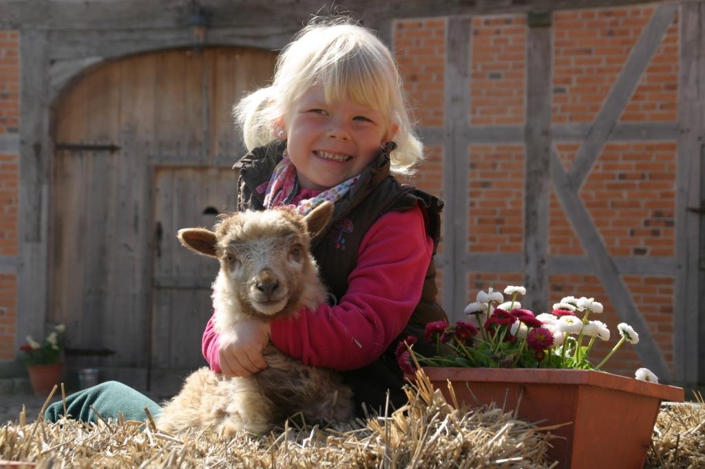 Kid-hugging-a-lamb-nice-full-photo